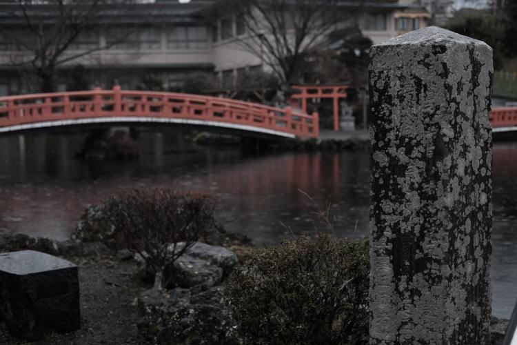 Foot bridge across Wakutama Pond in the rain, a spot near Mount Fuji